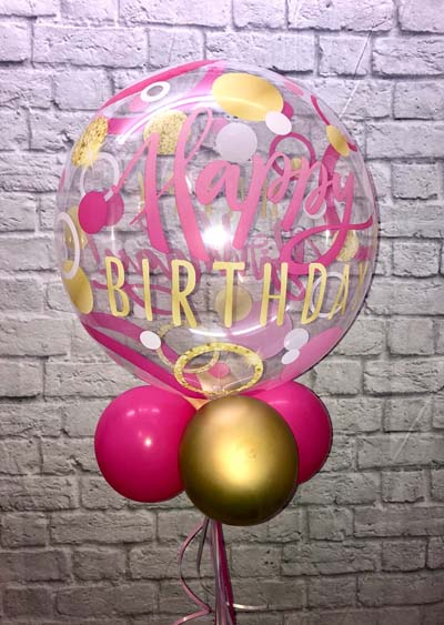 pink and gold birthday balloons