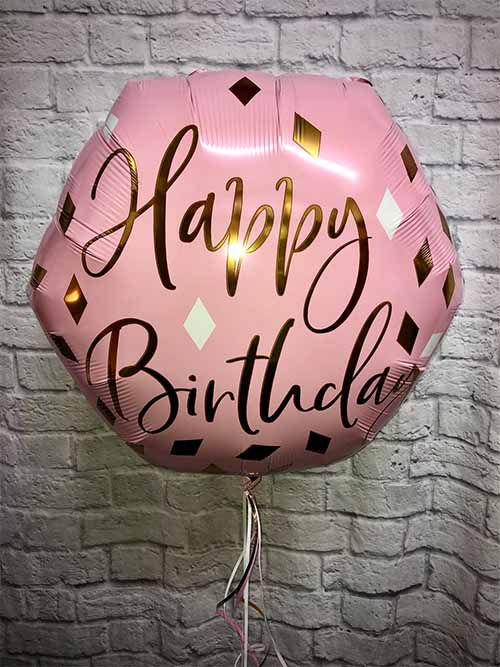 pink birthday balloon
