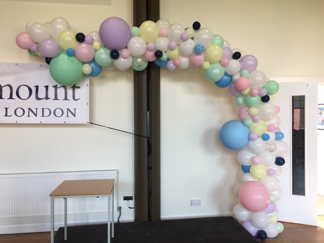 pastel colours and white arch