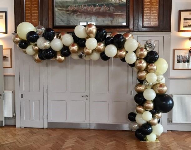 gold black and cream arch