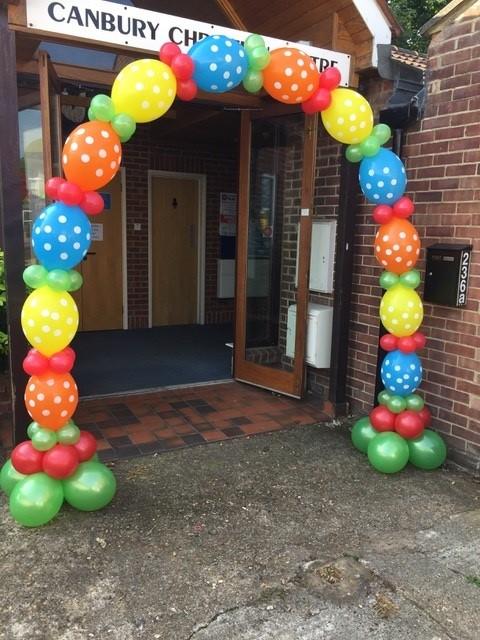 colourful dotty balloon arch