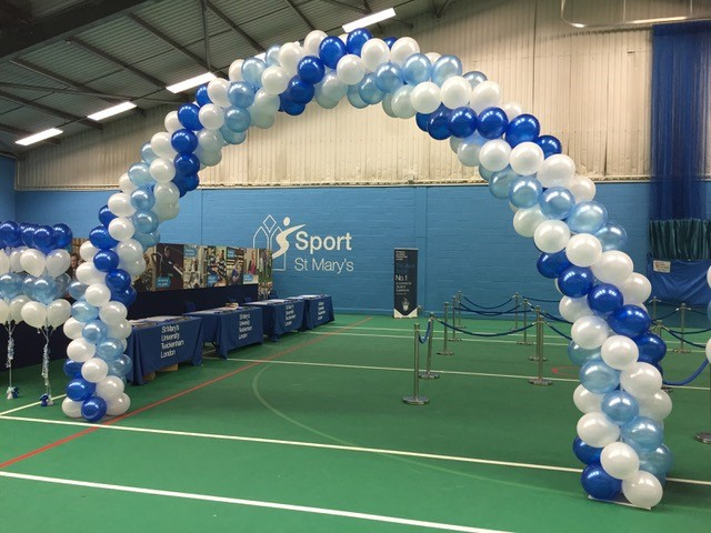 blues and white arch in sports hall